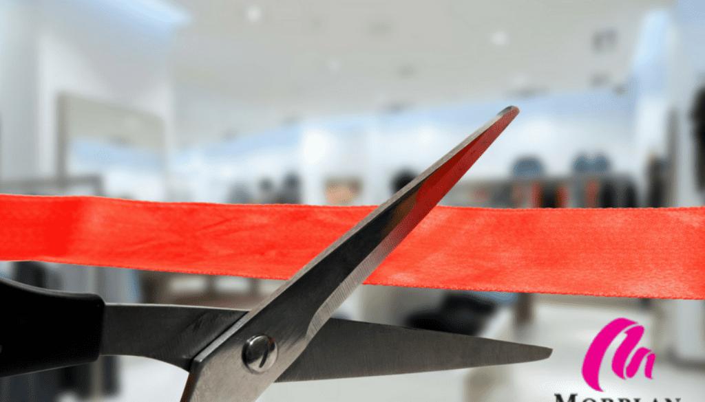 Scissors cutting ribbon